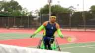MS Adaptive athletes warming up for doubles wheelchair tennis match