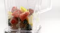 SLO MO LD Adding chia seeds to fruit in blender