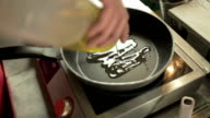 Adding Oil in a Cooking Pan
