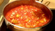 Adding raw garlic to a zucchini and tomato sauce