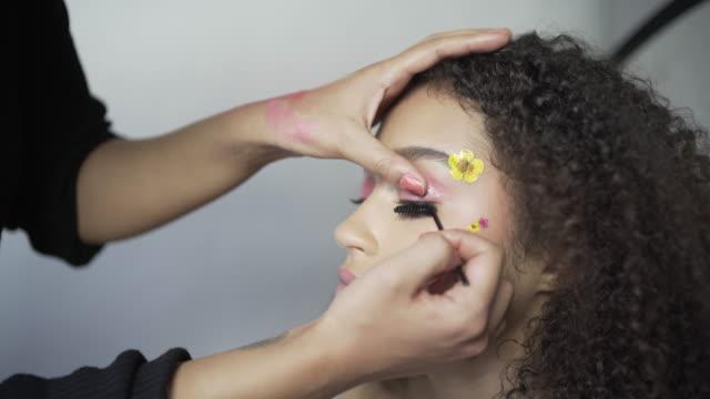 Adding the finishing touches with Mascara.