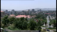 Addis Ababa cityscape / People sat outside Coptic Christian church ETHIOPIA Addis Ababa EXT Various of city skyline / High angle shots of traffic and...