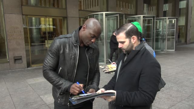 Adewale AkinnuoyeAgbaje signs for fans outside SiriusXM Satellite Radio Celebrity Sightings in New York on February 12 2014 in New York City