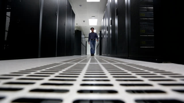 Administrator walking in the data center room