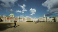 Admiralty house and Horse Guards Palace stand on the edge of Horse Guards Parade as tourists flow rapidly through the square