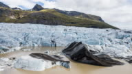 Admiring black and blue glacier ice