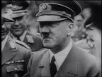 Adolf Hitler and Hermann Goering meeting with Nazi officers / graphic of the German Army advancing across Europe