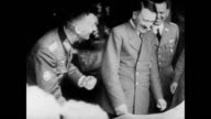 / Adolf Hitler and his officers consulting a map / Japanese officers consulting a map / Adolf Hitler laughing with his men Germany and Japan working...