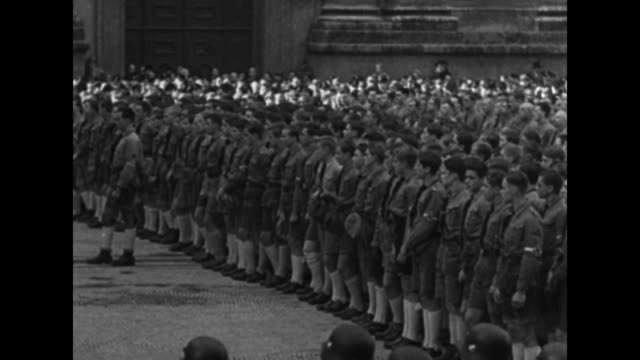 LS Adolf Hitler speaks at a lectern in front of the Feldherrnhalle on the anniversary of the Beer Hall Putsch and the Nazi rise to power Nazi...