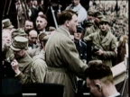 / Adolf Hitler takes his own life on April 30 1945 / Footage of Hitler's life and war / Nazi emblem and flag / Soldiers marching through street with...