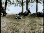/ Adolf Hitler takes his own life on April 30 1945 / Footage of Hitler's life and war / Soldiers and motorcycles run through woods in battle / Canons...