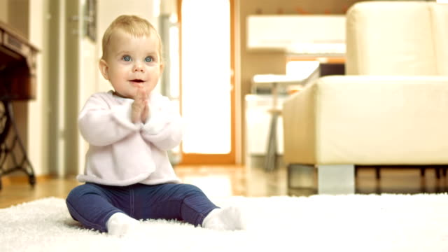Adorable Baby Girl Smiling And Clapping