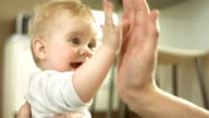 Adorable Baby Giving High Five