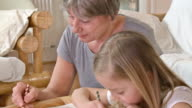 HD: Adorable Girl Drawing With Her Grandmother