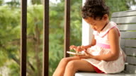 Adorable little asian girl playing on a digital tablet