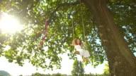 HD DOLLY: Adorable Little Girl Swinging On Tree Swing
