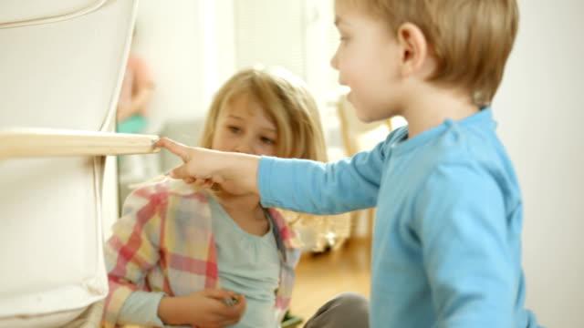 Adorable Siblings Playing At Home