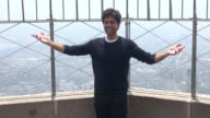 Adrian Grenier at the Empire State Building poses for photographers in Celebrity Sightings in New York