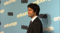 HD Adrian Grenier posing on carpet outside Ziegfeld Theater for press photographs