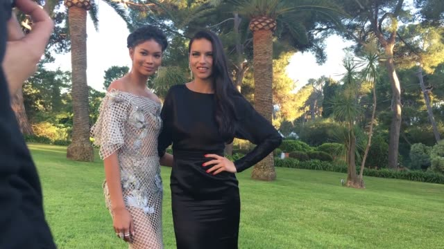 Adriana Lima Chanel Iman at amfAR's 23rd Cinema Against AIDS Gala Arrivals at Hotel du CapEdenRoc on May 19 2016 in Cap d'Antibes France