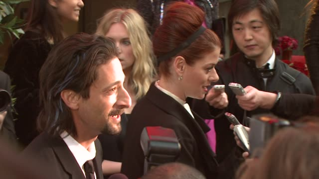 Adrien Brody and Debra Messing at the 8th Annual Tribeca Film Festival Chanel Dinner at New York NY