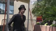 Adrien Brody leaves after the photocall and press conference of 'Midnight in Paris'