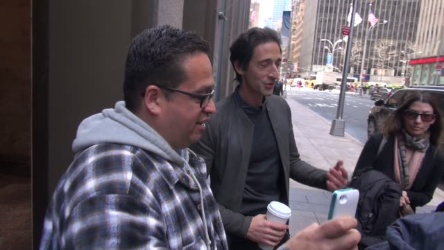 Adrien Brody leaving SiriusXM Satellite Radio stops to pose with fans answer a question in Celebrity Sightings in New York