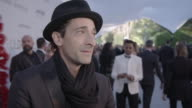 INTERVIEW Adrien Brody on being at amfAR on donating his painting for the auction at amfAR's 23rd Cinema Against AIDS Gala Arrivals at Hotel du...