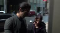 Adrien Brody stops to sign for a fan before going in to SiriusXM Satellite Radio in Celebrity Sightings in New York