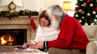 Adult couple examining financial documents