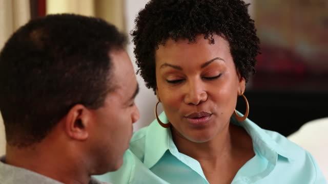 CU PAN Adult Couple Having Worried Conversation on Couch / Richmond, Virginia, USA
