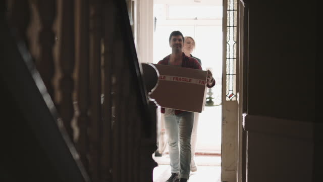 Adult Couple moving into new house with homeware