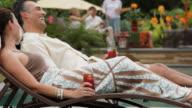 MS PAN Adult Couple on Vacation at Resort, Playing Footsie / Richmond, Virginia, USA