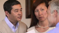 CU TU Adult Couple Speaking to Financial Advisor, Looking at Charts / Richmond, Virginia, USA