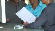 CU Adult Couple Talking with Financial Advisor about Mortgage Application / Richmond, Virginia, USA