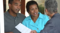 MS TU Adult Couple Talking with Financial Advisor, Signing Papers / Richmond, Virginia, USA