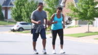 WS TS Adult Couple Walking for Exercise in Neighborhood / Richmond, Virginia, USA