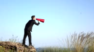 Adult Man Shouting Through Red Megaphone In Outdoor