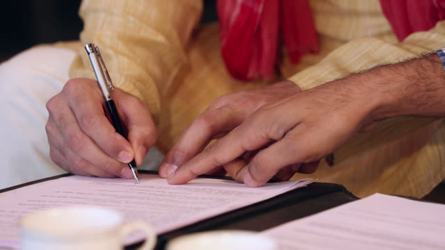 Adult man signing agreement