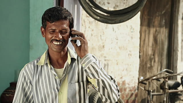 Adult man talking on a mobile phone, Haryana, India