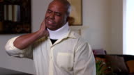 Adult Man Wearing Neck Brace Expresses Discomfort