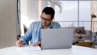 Adult man working from home using his laptop
