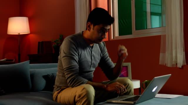 Adult man working on laptop, Delhi, India