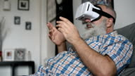 adult senior man and a virtual reality headset. graybearded man using vr glasses