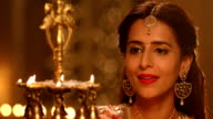 Adult woman burning oil lamp In diwali festival, Delhi, India