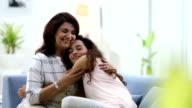 Adult woman hugging her daughter, Delhi, India