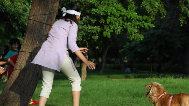 Adult woman playing with kids in the park, Delhi, India
