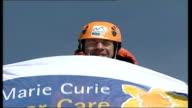 Sir Ranulph Fiennes conquers the Eiger Mountaneers holding flag showing their support for the Marie Curie Cancer Care charity Overfly of the Eiger...