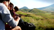 Adventures on the Dolomites: friends plan tour with maps
