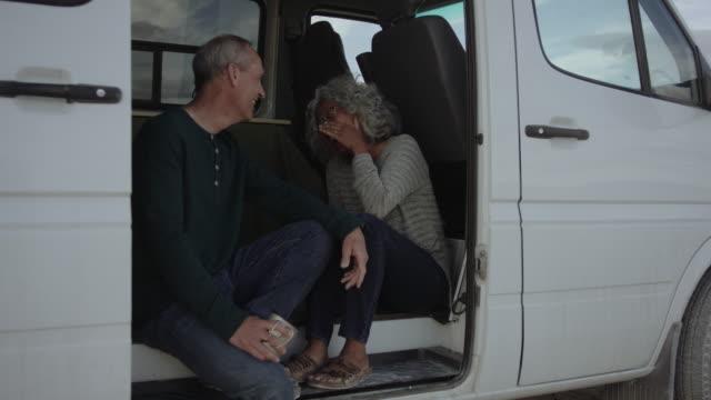 Adventurous Senior Couple Having a Laugh in Their Campervan